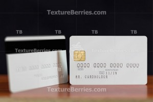 Two sides of blank white credit card with embossing