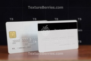 Two sides of white credit card with embossing