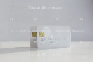Two white blank credit card on soft blurred background