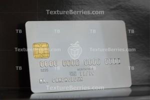White bank card on dark background