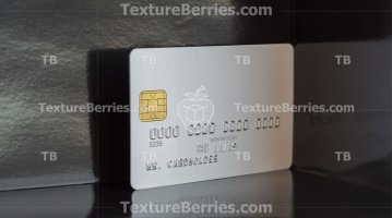 White bank card with reflections on dark background