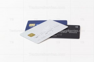 White, black and blue credit cards on white background