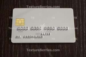 White blank bank card on wooden background