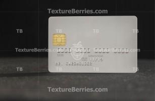White blank bank credit card on dark background