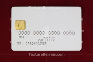 White blank bank credit card on red background