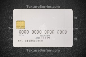 White blank credit card on black leather background