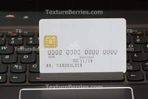 White credit card on laptop keyboard, online shopping