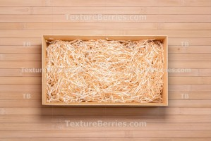 Wine box with decorative filler on bamboo, top view