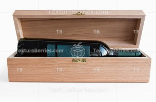 Wooden gift box with wine bottle